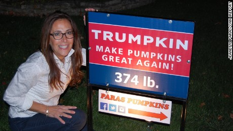Jeanette Paras and the sign for her 2015 Trumpkin creation