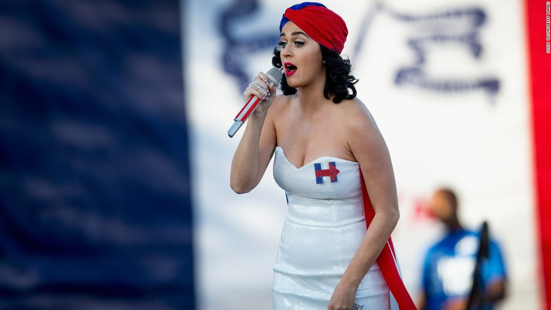 "Katy Perry, wearing Clinton's famous H logo on her white dress, rallies Clinton supporters outside a dinner in Des Moines, Iowa, in October.<br /><br />Perry has been <a href=""http://www.cnn.com/2015/10/26/politics/hillary-clinton-birthday-celebrities/"" target=""_blank"">outspoken on social media</a> about her support for Clinton."