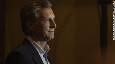"Buenos Aires Mayor and presidential candidate for ""Cambiemos"" party Mauricio Macri arrives for a press conference in Buenos Aires, on October 26, 2015 after a general election. Buenos Aires Governor and presidential candidate for the ruling ""Frente para la Victoria"" party Daniel Scioli won a first round of Argentina's presidential race and will go to a run-off election with Buenos Aires Mayor and presidential candidate for ""Cambiemos"" party Mauricio Macri, next November 22. The two candidates led a close final race, with Scioli taking nearly 37 percent of the vote to almost 34.5 percent for Macri, with 96 percent of polling stations reporting.    AFP PHOTO / JUAN MABROMATA        (Photo credit should read JUAN MABROMATA/AFP/Getty Images)"