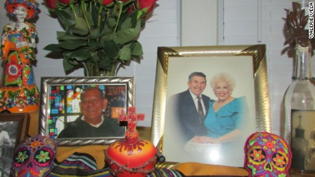 Valerie Vela honors her loved ones by placing this altar in her home each year