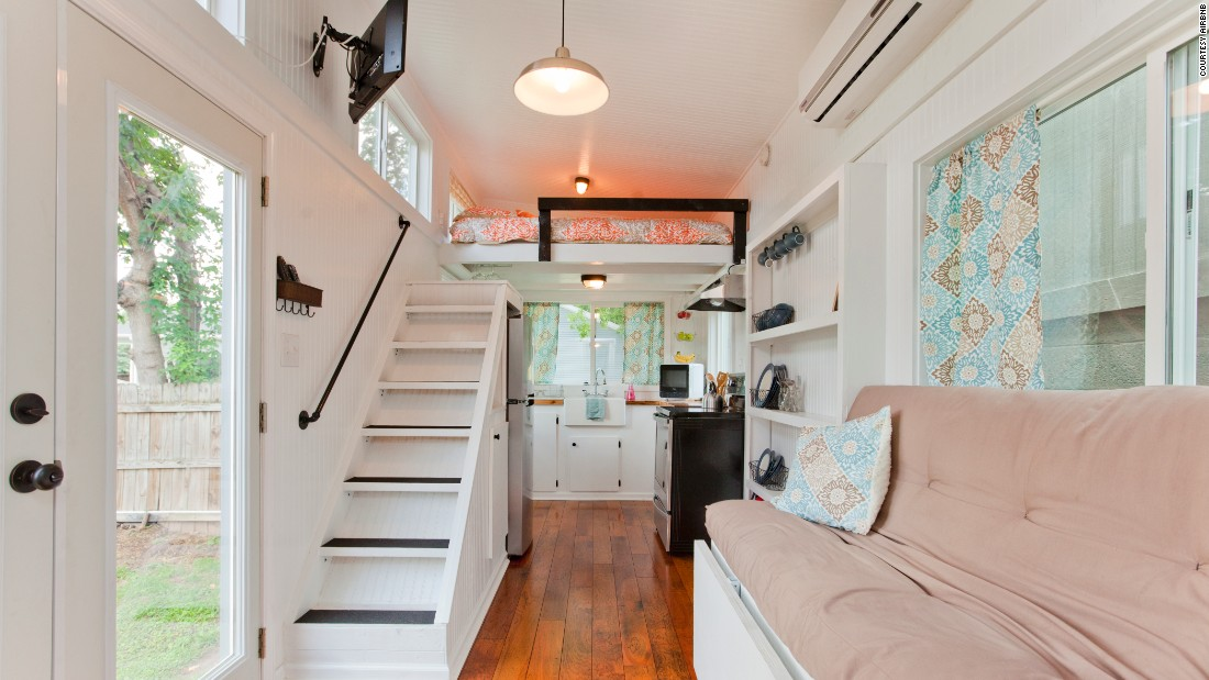 "This light and airy tiny home in Nashville sleeps four and has a full kitchen. The house <a href=""https://www.airbnb.com/rooms/3207994"" target=""_blank"">rents for $119 per night</a>."
