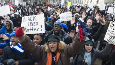 Thousands take part in the Justice for All March and Rally on Pennsylvania Avenue to the US Capitol in Washington, DC, on December 13, 2014, to protest the killings of unarmed African-Americans by police officers and the decisions by Grand Juries to not indict them. AFP PHOTO / SAUL LOEB        (Photo credit should read SAUL LOEB/AFP/Getty Images)