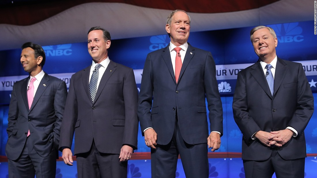 From left, Bobby Jindal, Rick Santorum, George Pataki and Lindsey Graham take the stage for the second-tier GOP debate that took place before the main event at the University of Colorado.
