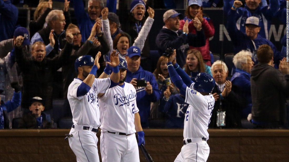 The Royals' Alex Rios, from left, Kendrys Morales and Alcides Escobar celebrate after scoring runs in the fifth inning.