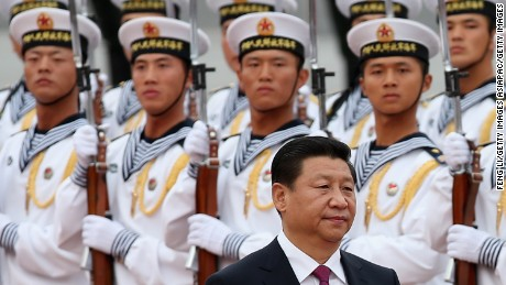 BEIJING, CHINA - SEPTEMBER 16:  Chinese People's Liberation Army navy soldiers of a guard of honor look at Chinese President Xi Jinping (Front) during a welcoming ceremony for King Hamad Bin Isa Al Khalifa of Bahrain outside the Great Hall of People on September 16, 2013 in Beijing, China. At the invitation of Chinese President Xi Jinping, King Hamad Bin Isa Al Khalifa of Bahrain paid a state visit to China from September 14 to 16.  (Photo by Feng Li/Getty Images)