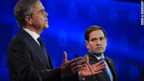 Marco Rubio, right, watches as Jeb Bush speaks during the CNBC Republican presidential debate at the University of Colorado, Wednesday, Oct. 28, 2015, in Boulder, Colo. (AP Photo/Mark J. Terrill)