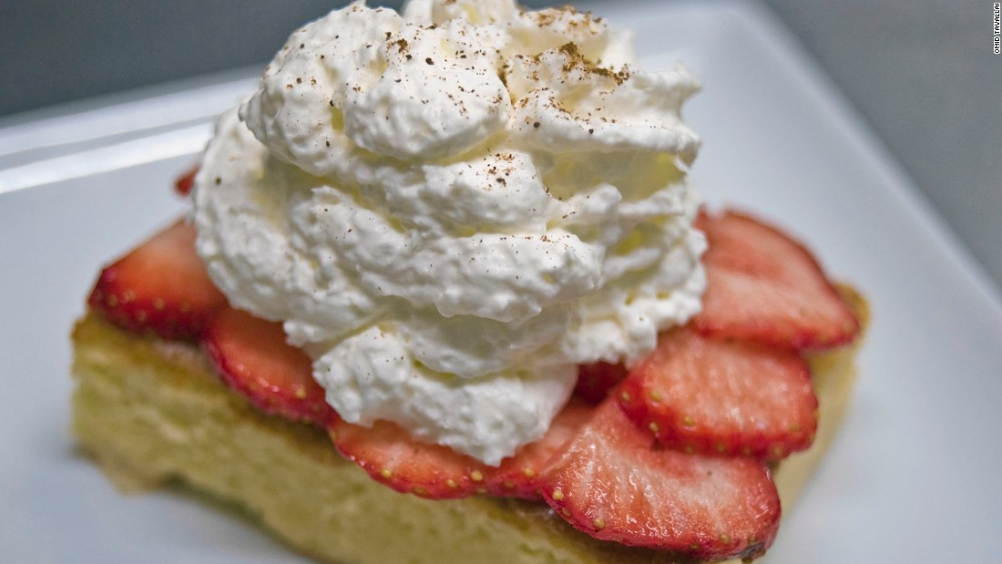 The tres leches cake is found in many Latin American cities. The dessert is a sponge cake soaked in condensed milk, evaporated milk and regular milk and topped with whipped cream.