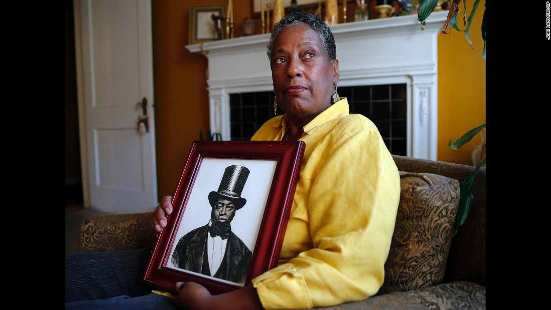 Ocea Thomas of Atlanta, here with a picture of her ancestor, Samuel D. Burris, helped write letters in support of a pardon for Burris. Delaware Gov. Jack Markell on Monday, November 2, pardoned Burris, a free black man and conductor on the Underground Railroad who died in 1863. Burris was convicted of helping slaves escape to freedom in the 1840s.