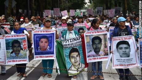 Relatives of the 43 missing students from Ayotzinapa school take part in a protest in Mexico City.