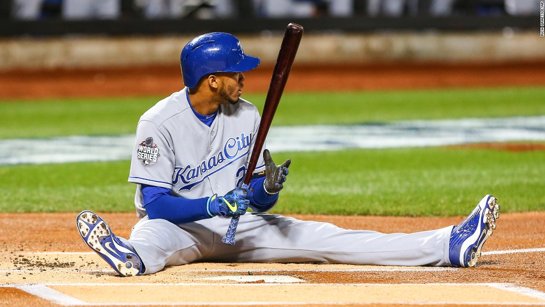 Royals shortstop Alcides Escobar sits in the batter's box after a pitch knocked him down.