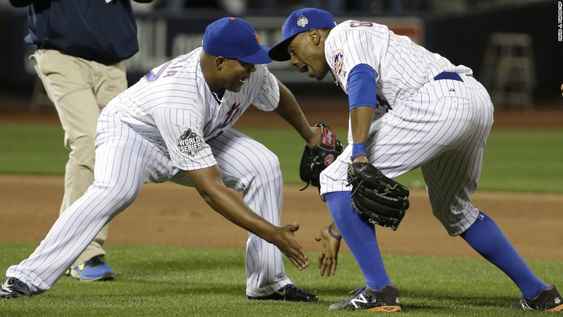 The Mets' Jeurys Familia and Curtis Granderson celebrate after beating the Royals in Game 3 in New York on Friday, October 30.
