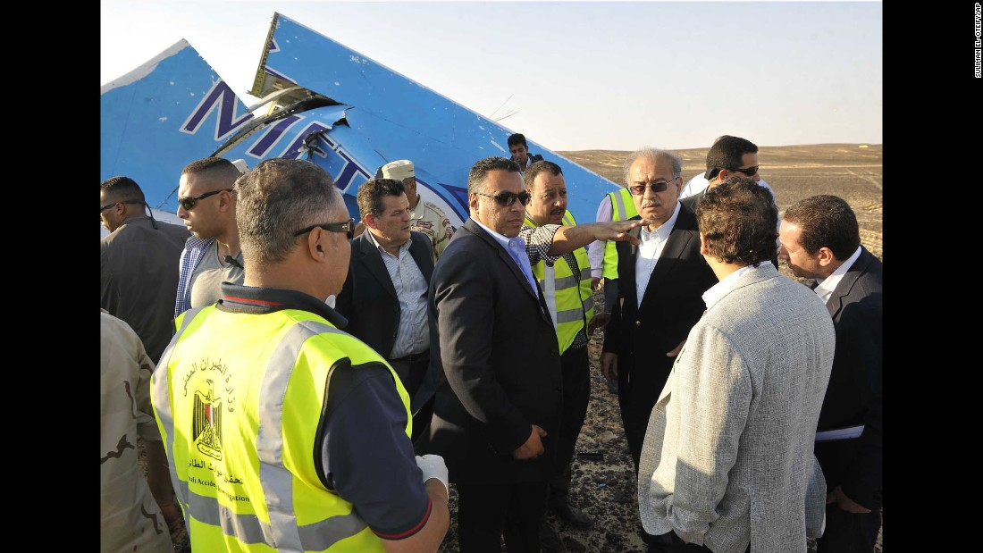 Egyptian Prime Minister Sherif Ismail, third from right, visits the site of the plane crash with military and government officials on October 31.