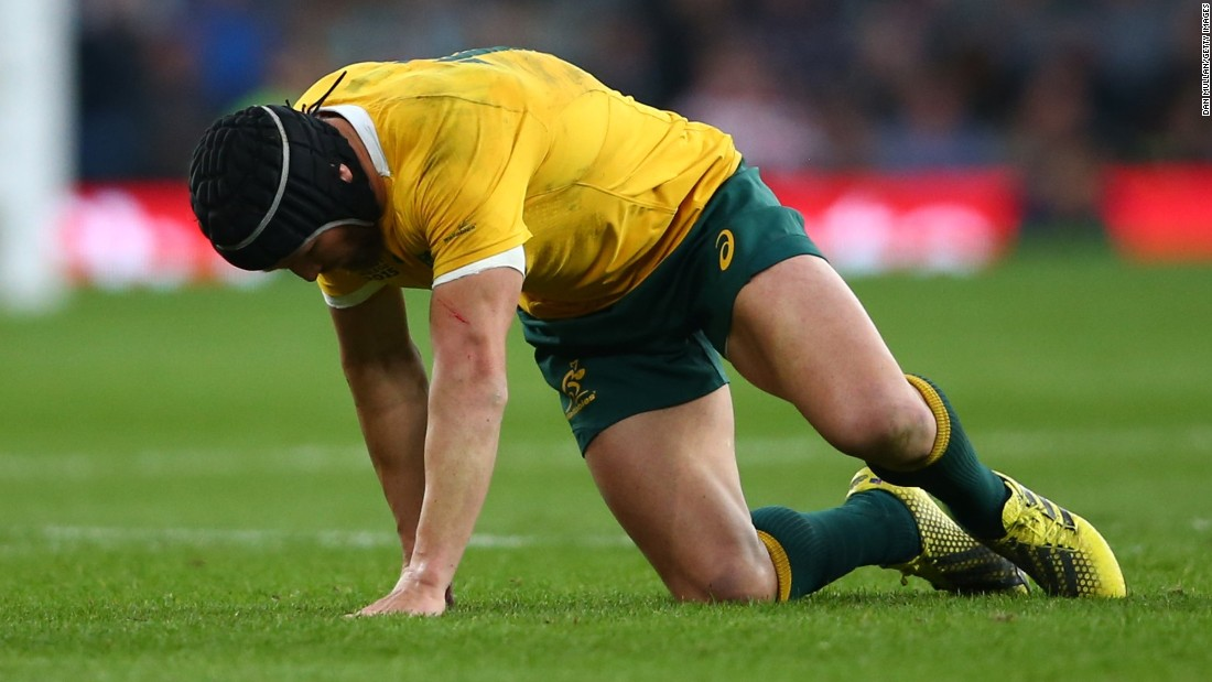 Matt Giteau of Australia made a sorry first half exit for the Wallabies after picking up an injury.