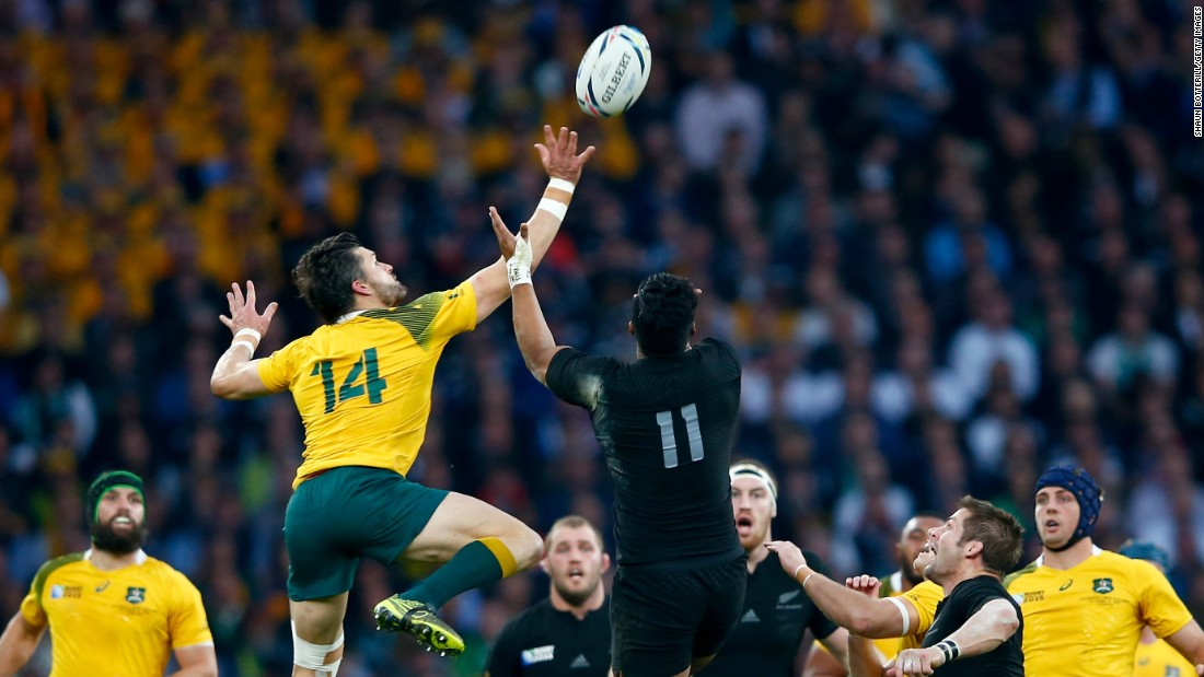 Adam Ashley-Cooper of Australia and Julian Savea of New Zealand challenge for the high ball early in the final.