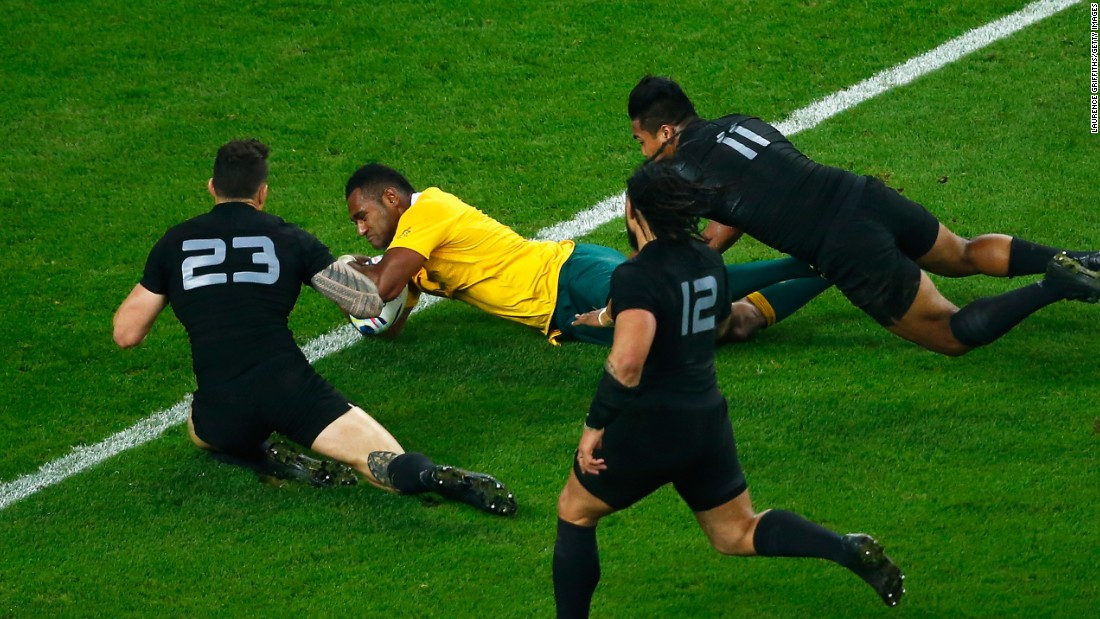 Tevita Kuridrani holds off Sonny Bill Williams and Savea to dive over for Australia's second try in a second half fightback, which was eventually in vain.