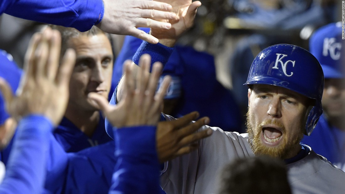 The Royals' Ben Zobrist celebrates in the dugout after scoring on an RBI single by Lorenzo Cain in the sixth inning.