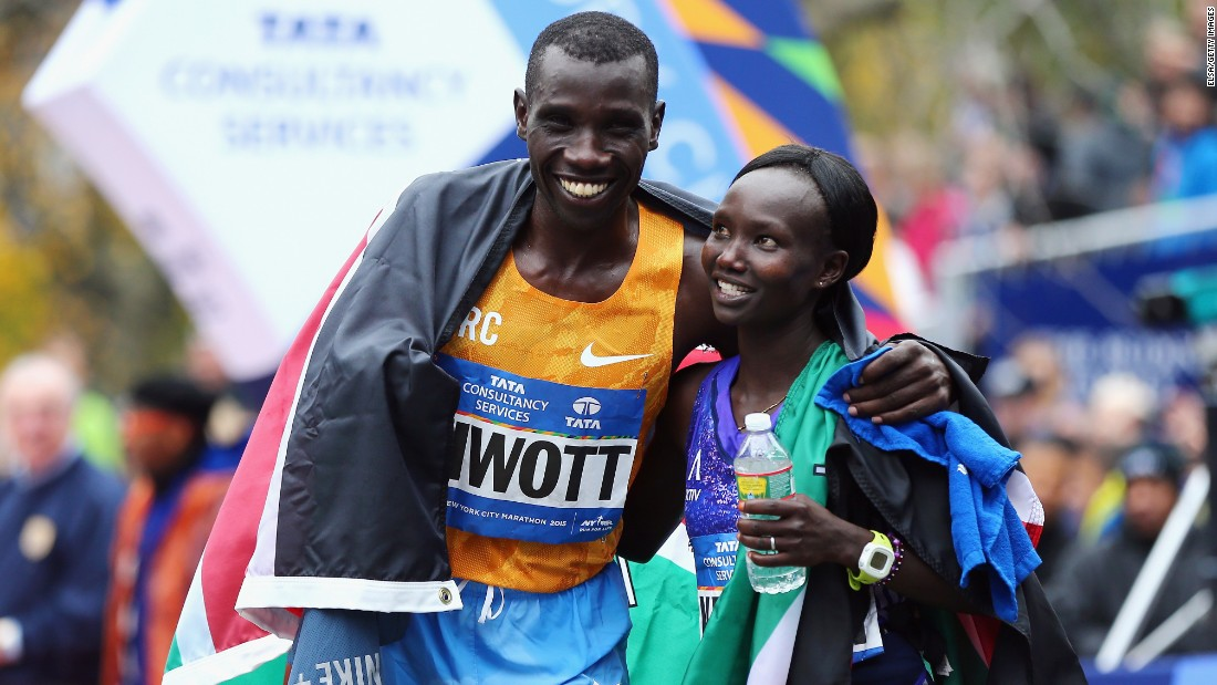 "Pro Men's Division winner Stanley Biwott of Kenya, left, poses with Pro Women's Division winner Mary Keitany, <a href=""http://bleacherreport.com/articles/2584896-new-york-marathon-results-2015-mens-and-womens-top-finishers?utm_source=cnn.com&utm_medium=referral&utm_campaign=editorial"" target=""_blank"">also of Kenya</a>."