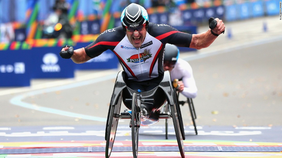 Ernst van Dyk of South Africa celebrates as he crosses the finish line to win the Men's Professional Wheelchair Division.