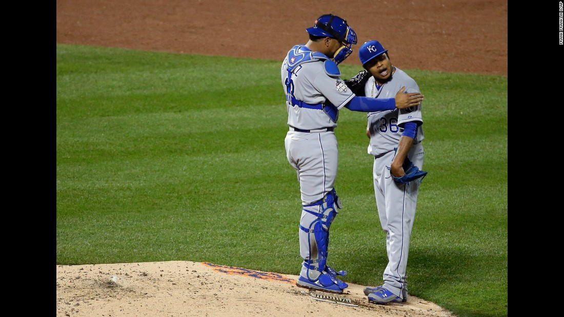 Kansas City Royals catcher Salvador Perez talks to pitcher Edinson Volquez during the sixth inning.