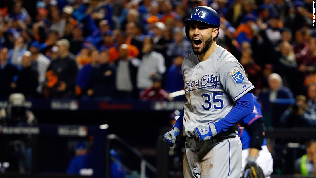 Kansas City Royals' Eric Hosmer celebrates after scoring a run off a grounded-out hit by Salvador Perez to tie the game in the ninth inning.