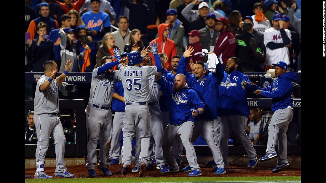 Eric Hosmer of the Kansas City Royals celebrates with his teammates after scoring a run in the ninth inning.