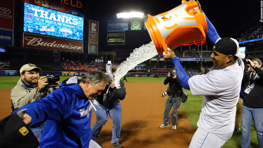 Salvador Perez of the Kansas City Royals douses manager Ned Yost after the team defeated the New York Mets.