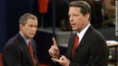 ST. LOUIS:  Democratic presidential nominee Al Gore answers a question as Republican presidential nominee George W. Bush listens during their third debate at Washington University on October 17, 2000.