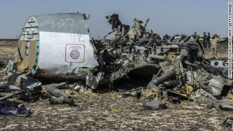 Debris from a Russian airliner lies on the ground on November 1, a day after the jet crashed in Egypt's Sinai Peninsula.
