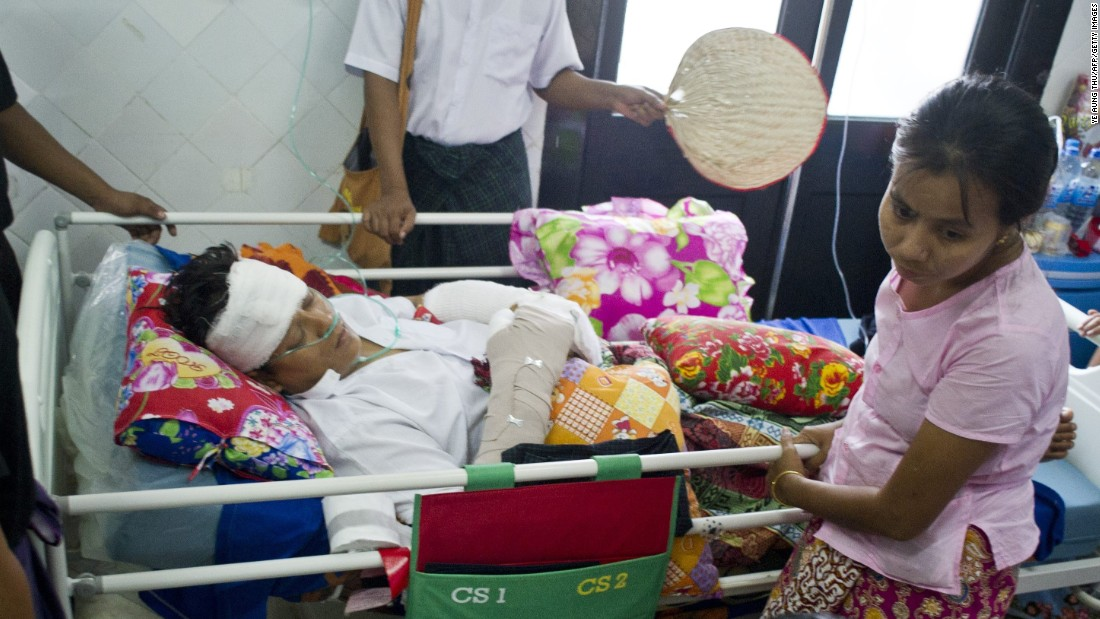 Naing Ngan Linn, a Myanmar opposition candidate and member of the parliament, is treated at the Yangon General Hospital on October 30, 2015. He suffered injuries from a machete attack while touring Yangon's Tharketa township on October 29.