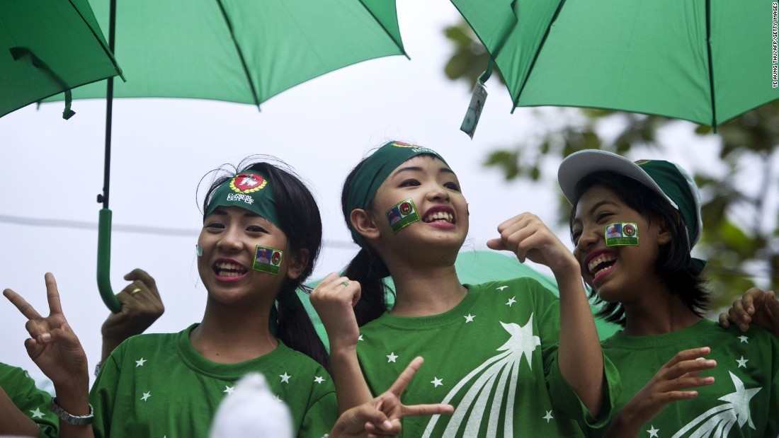 Singers perform on a motorcade during a campaign rally by supporters of the army-backed ruling Union Solidarity and Development Party (USDP) in Yangon on October 30.