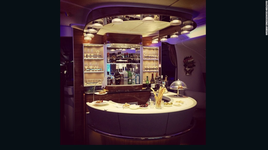 """""""Credit card reward schemes, millage running, airlines selling miles at a discount -- these are things that anyone can do to travel in premium comfort at a huge discount,"""" said Schlappig, who is not adverse to cocktails on an Emirates first class bar (pictured).<br /><br />""""So you're basically paying economy prices for traveling first class."""""""