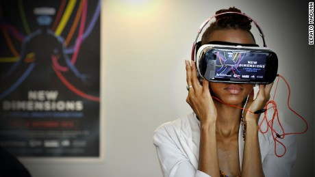 A woman tries a virtual reality headset at an exhibition at the African Futures Exhibition at the Goethe Institut, Johannesburg.