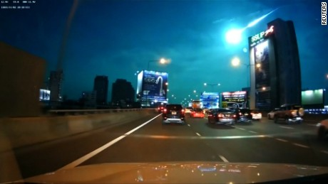 Edit No:2107  Revision 1  THAILAND-METEOR/    Green fireball seen falling across Bangkok night sky      THIS EDIT CONTAINS USER-GENERATED CONTENT THAT WAS UPLOADED TO A SOCIAL MEDIA WEBSITE. REUTERS' SOCIAL MEDIA TEAM HAS VERIFIED THE CONTENT AND OWNERSHIP BY CONTACTING THE UPLOADER AND HAS RECEIVED PERMISSION TO DISTRIBUTE IT.     Dashcam captures a green fireball believed to be a burning meteor falling above Thailand's capital, Bangkok.