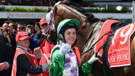 Prince Of Penzance jockey Michelle Payne celebrates after winning the Melbourne Cup at the Flemington Racecourse in Melbourne, Australia, on Tuesday, November 3. She is the first woman to win the race.