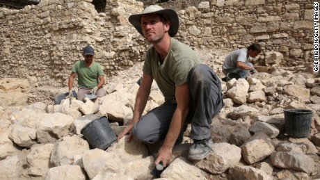 "Workers from the Israeli Antiquity Authorities dig on November 3, 2015 at the excavation site near the City of David adjacent to Jerusalem's Old City walls where researchers believe to have found the remains of the stronghold the Acra, from which the Greek King Antiochus IV was able to control Jerusalem and monitor activity at the holy site known to Jews as the Temple Mount. Israel's antiquities body claimed to have solved ""one of Jerusalem's greatest archeological mysteries"" by unearthing from under a car park the 2,000-year-old citadel, which archaeologists have puzzled for more than a century over its location."