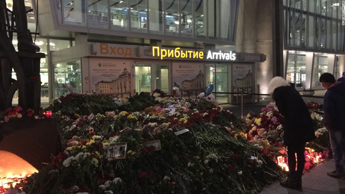 By nightfall a day after the crash, the impromptu memorial was spilling out all along the arrivals entrance to the airport.