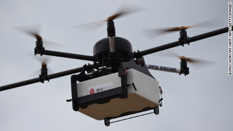 This picture taken on September 28, 2015 shows a Geopost drone flying in Pourrieres, southeastern France, during a presentation of a prototype of a package delivery drone. Geopost is a branch of the French La Poste group. AFP PHOTO / BORIS HORVAT        (Photo credit should read BORIS HORVAT/AFP/Getty Images)