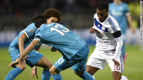 Lyon's French forward Alexandre Lacazette (R) vies with Zenit's Portuguese defender Luis Neto (C) and Zenit's Belgian midfielder Axel Witsel (L) during an UEFA Champions League Group H football match between Lyon and Zenit Saint-Petersburg at the Stade de Gerland stadium in Lyon, southeastern France on November 4, 2015.  AFP PHOTO / PHILIPPE DESMAZES        (Photo credit should read PHILIPPE DESMAZES/AFP/Getty Images)