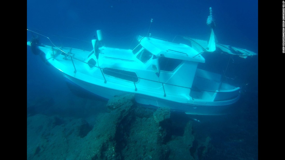 The Kusadasi Ilgun, a sunken 20-foot boat, lies in waters off the Greek island of Samos in November 2016.