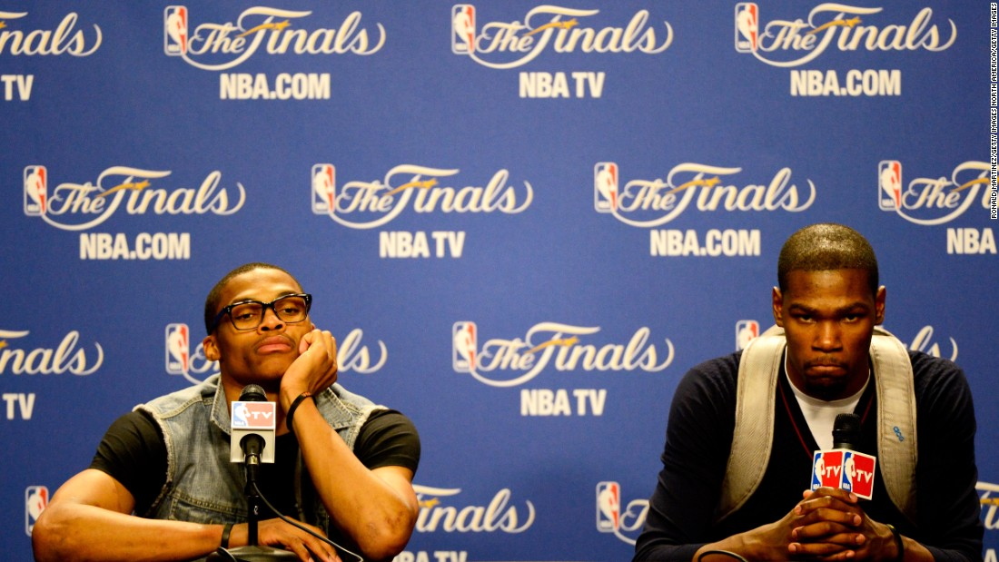 Russell Westbrook (L) and Oklahoma City Thunder teammate Kevin Durant played with different looks during the 2012 NBA Finals. Durant would often wear a backpack as a style accessory to press conferences.