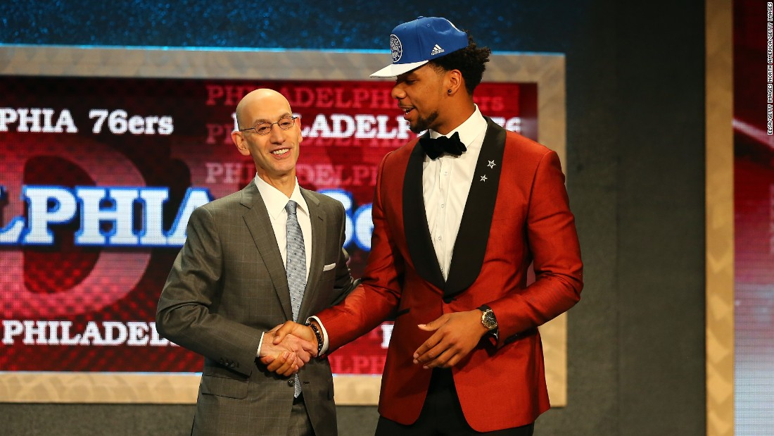 Jahlil Okafor (right) sports a red tuxedo as he greets NBA commissioner Adam Silver after being selected third overall by the Philadelphia 76ers.