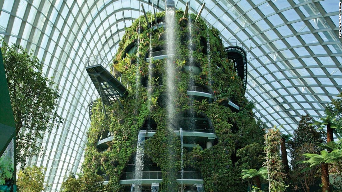 "The two climates contained are the ""Flower Dome,"" which features a cool dry environment, and the ""Cloud Forest,"" which features a cool and moist environment. The structure covers an area of over 20,000 square meters and features an indoor waterfall."