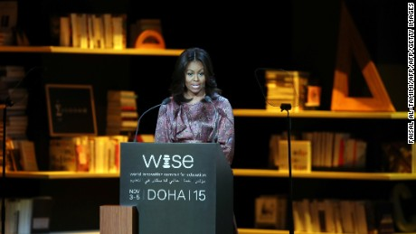 "US first lady Michelle Obama delivers a speech during the World Innovation Summit for Education (WISE) held the convention center in the Qatari capital Doha on November 4, 2015. The US first lady, on a seven-day tour of the Middle East, told the education conference that an ""honest conversation"" was needed around the globe about how women were treated and how this prevented millions of girls from finishing school. AFP PHOTO / FAISAL AL-TAMIMI        (Photo credit should read FAISAL AL-TAMIMI/AFP/Getty Images)"