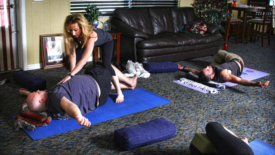 "Dana Santas, center, creator of <a href=""http://www.radiusyoga.com/"" target=""_blank"">Radius Yoga Conditioning</a>, recently taught a yoga session at the Veterans Alternative Center in Holiday, Florida. The goal? To help ""reconnect their mind, body and spirit on the mat."""