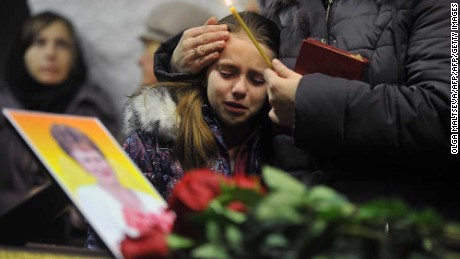 A girl cries during a funeral this month for Nina Lushchenko, 60, a victim of the Metrojet crash.
