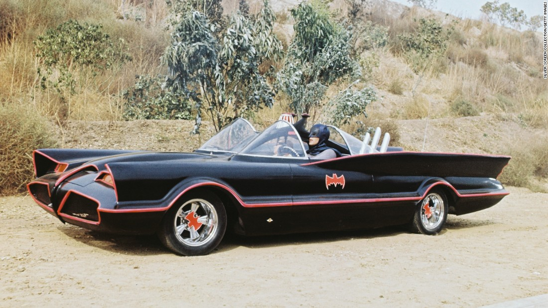 "Above is an image from the ""Batman"" television series in 1966. Adam West who played Batman and Burt Ward who played Robin are both seated in the car. The Batmobile was actually a modified 1955 Lincoln Futura concept car."