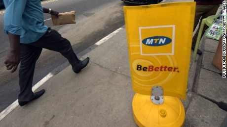 A man walks past a MTN notice board in Lagos, on October 27, 2015.  Nigeria's telecommunications regulator has fined South African mobile giant MTN $5.2 billion for missing a deadline to disconnect unregistered SIM cards, the company announced on Monday. The penalty saw shares in Africa's largest telecommunications company crash more than 12 percent to 167 rand on the Johannesburg Stock Exchange, the biggest fall the firm has suffered in a day since November 1998. AFP PHOTO/PIUS UTOMI EKPEI        (Photo credit should read PIUS UTOMI EKPEI/AFP/Getty Images)