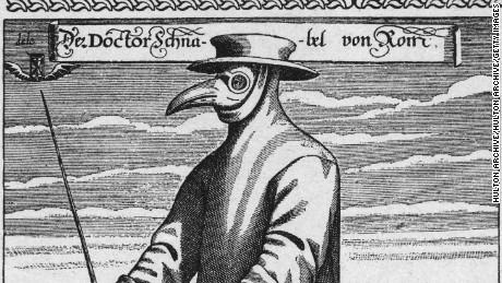 Circa 1656, a plague doctor in protective clothing.