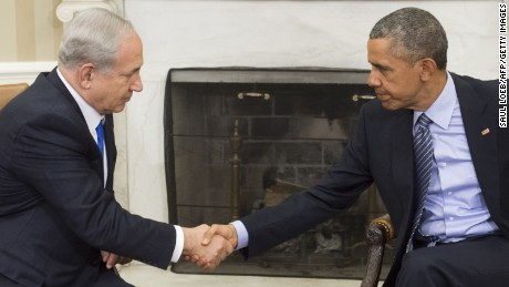 US President Barack Obama(R) and Israeli Prime Minister Benjamin Netanyahu shake hands during a meeting in the Oval Office of the White House in Washington, DC, November 9, 2015.