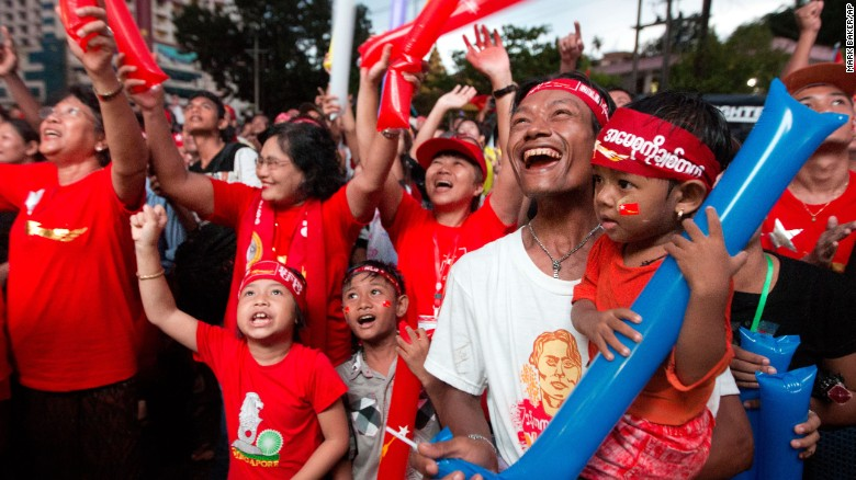 Supporters of Myanmar's National League for Democracy party cheer as election results are posted outside the NLD headquarters in Yangon, Myanmar, on Monday, November 9.